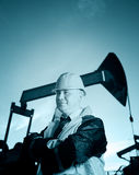 Worker in an Oil field Stock Photo