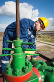 Worker on the oil field Stock Photo