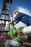 Worker on the oil field. Refinery, oil and gas Stock Photo