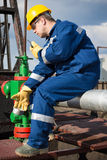 Worker on the oil field Royalty Free Stock Image