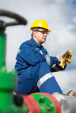 Worker on the oil field Royalty Free Stock Photo