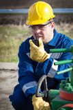 Worker on the oil field. Refinery, oil and gas Stock Image
