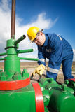 Worker on the oil field Stock Image