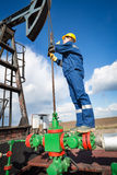 Worker on the oil field. Refinery, oil and gas Royalty Free Stock Photo