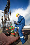 Worker on the oil field Royalty Free Stock Images