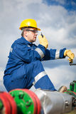 Worker on the oil field Stock Photos