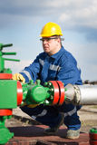 Worker on the oil field Royalty Free Stock Photos