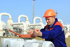 Worker opening bypass valve Stock Images