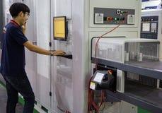 Worker operate Flexible Loader Machine stock photo