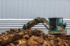 Worker operate truck timber grab for transport and loading Royalty Free Stock Photos