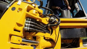 A Worker Operates Heavy Machinery stock video