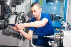 Worker operating CNC machine center Stock Photos