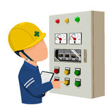 Worker is operating control panel Royalty Free Stock Photos