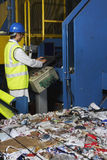 Worker Operating Conveyor Belt In Recycling Factory Royalty Free Stock Photo