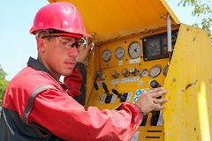Worker Operating Drilling Rig Control Panel Stock Photo