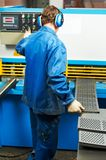 Worker operating guillotine shears Stock Photo
