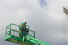 Worker Operating Lift stock photography