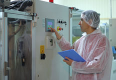 Worker operating a machine Stock Photography