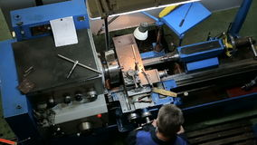 Worker operating in manual lathe stock footage