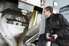 Worker operating metal machining center Royalty Free Stock Photography