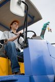 Worker operator. The worker operates a steamroller stock image