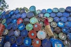 A worker organizes barrels at Karnafuli Rivers Sadarghat areas, Chittagong, Bangladesh. Karnafuli River Sadarghat areas, Chittagong, Bagladesh. Chittagong is Stock Photos