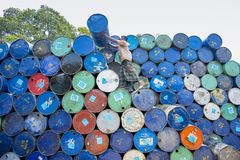 A worker organizes barrels at Karnafuli Rivers Sadarghat areas, Chittagong, Bangladesh. Karnafuli River Sadarghat areas, Chittagong, Bagladesh. Chittagong is Royalty Free Stock Photo