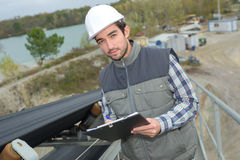 Worker in outdoor site. Worker in an outdoor site Royalty Free Stock Images