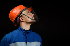 Worker in overalls and a helmet Stock Photo