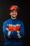 The worker in overalls and a helmet Stock Photography