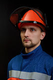 The worker in overalls and a helmet Royalty Free Stock Photos