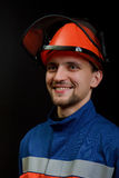 The worker in overalls and a helmet Stock Photo
