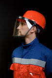 The worker in overalls and a helmet Royalty Free Stock Photography