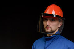The worker in overalls and a helmet Royalty Free Stock Photo