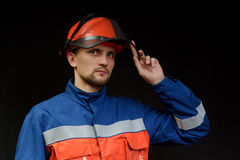 The worker in overalls and a helmet Stock Photos
