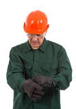 Worker in overalls and helmet ready for work Stock Photo