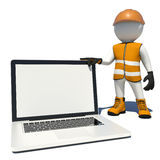 Worker in overalls holding laptop white empty Royalty Free Stock Image