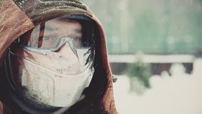 Worker in overalls wears a protective mask on his face stock footage