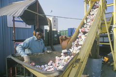 A worker overseeing aluminum cans Stock Photos