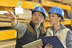 Worker with overseer controling stock. In warehouse Stock Photos
