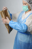 Worker packing bag Stock Image