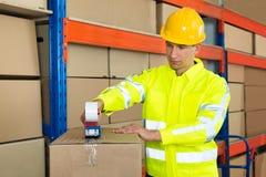 Worker Packing Cardboard Box Stock Photo