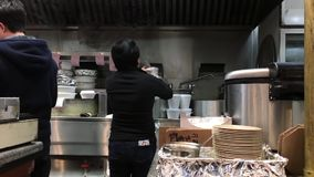 Worker packing food for customer stock video footage