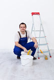 Worker with paint, brush and ladder Stock Image