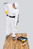 Worker paint primer wooden floor Stock Photos