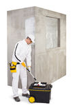 Worker with a painter roller brush and primer Stock Images