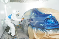 Worker painting auto car body Stock Photo