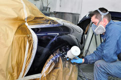 Worker painting a car. Stock Photography