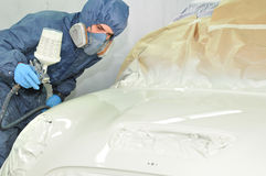 Worker painting car. Stock Photos