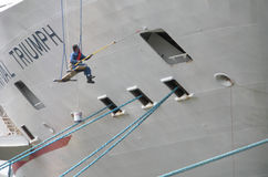 Worker Painting A Cruise Ship Docked in the Hudson River, New York, USA stock photos